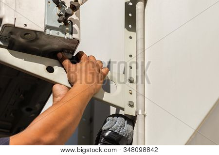 Close up of Air conditioning repair man hand uninstall air conditioner compressor, Technician fixing air conditioning system stock photo