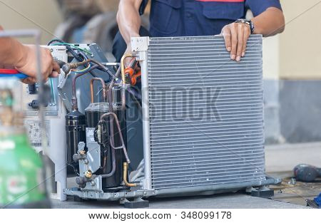 Close up of Air Conditioning Repair team use fuel gases and oxygen to weld or cut metals, Oxy-fuel welding and oxy-fuel cutting processes, repairman on the floor fixing air conditioning system stock photo