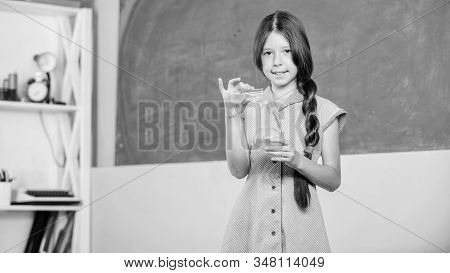 Chemical reaction. Chemical liquid. Science lesson. School laboratory. Small girl with chemical tube. Biology education. Girl chemistry class testing tube. Scientific experiment. Fascinating lesson stock photo