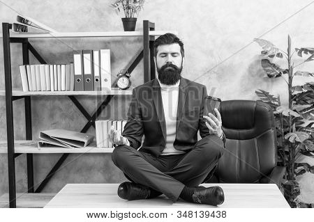 Self care. Psychological help. Relaxation techniques. Mental wellbeing and relax. Man bearded manager formal suit sit lotus pose relaxing. Prevent professional burnout. Way to relax. Meditation yoga. stock photo