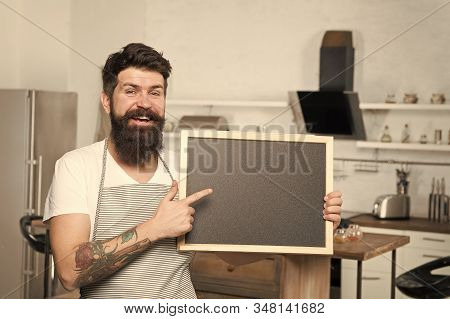 Check out menu. Man chef apron hold blackboard copy space. Recipe concept. Cooking delicious meal step by step. Menu for today. List ingredients for cooking dish. Excellent home food. Home menu. stock photo