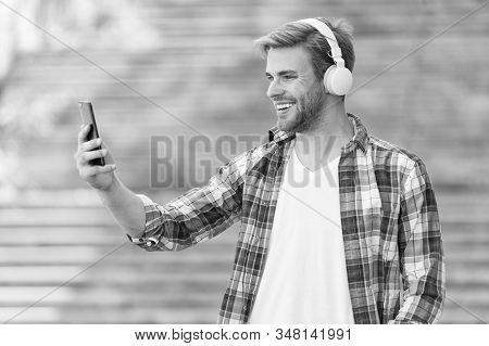 College student earphones smartphone. Online education. Audio book concept. Educational technology. student e learning. school life. Listen music. Modern and digital youth. happy man. selfie lover. stock photo