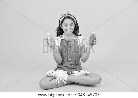 Buy diet food. Happy little child hold bottles with diet food. Small girl enjoy natural diet. Feel nourished and energized with diet meal. Healthy dieting. Nutrition and health care. stock photo