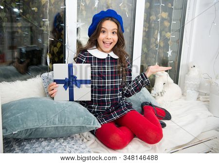 Advertising product. Happy child show product with hand. Presenting holiday gift. Christmas advertising. Focus on holiday advertising. Advertisement. Promotion and marketing. Festive advertising. stock photo