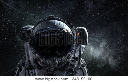 Astronaut pioneer doing research. Mixed media stock photo