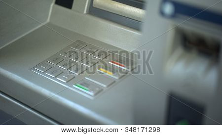 Close-up of automated teller machine, buttons on ATM, secure money withdrawing stock photo