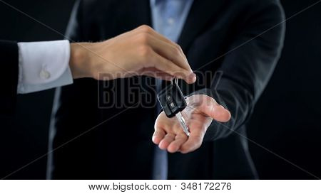 Man receiving car keys from agent, businessman buying auto, transport rent stock photo
