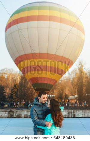 Loving couple stands on ice on Valentines Day, behind the air ball. stock photo