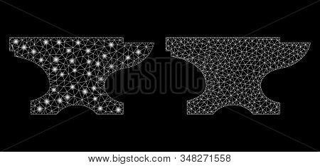 Bright mesh forge with glare effect. Abstract illuminated model of forge icon. Shiny wire carcass polygonal mesh forge icon. Vector abstraction on a black background. stock photo