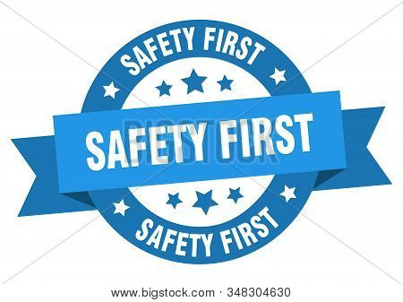 safety first ribbon. safety first round blue sign. safety first stock photo