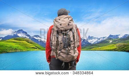 Alpine peaks landskape background. Bachalpsee lake, Grindelwald, Bernese highland. Alps, tourism, journey, hiking concept. stock photo
