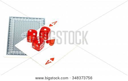 Red dice on ace of hearts on white background detail isolated stock photo