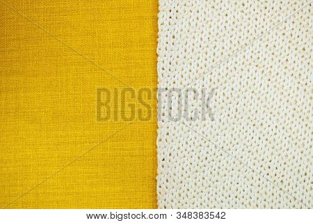 background from two part yellow textile and white knitting cloth, copy space. stock photo