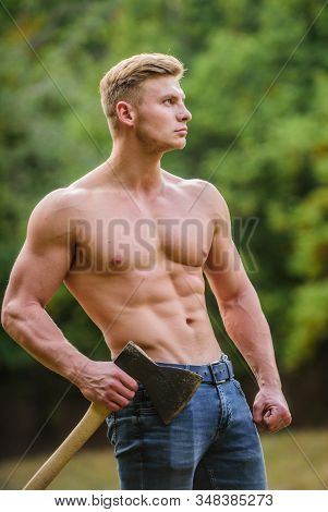 Muscular body. Surviving in wild nature. Brutality is sexy. Strength and power concept. Sexy macho bare torso. Handsome shirtless man muscular body. Muscular athlete in forest. Sport and fitness stock photo