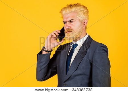 Business communication. Call his lawyer. Real estate agent. Serious conversation. Application online services. Man with smartphone. Modern communication. Mobile communication. Communicative skills stock photo