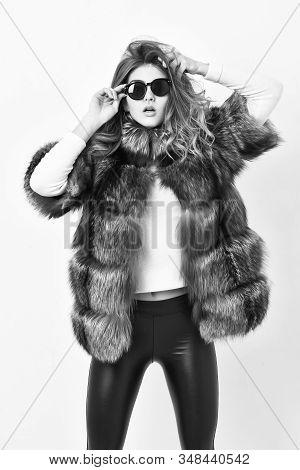 Woman wear sunglasses and hairstyle posing mink or sable fur coat. Fur fashion concept. Winter elite luxury clothes. Female brown fur coat. Fur store model enjoy warm in soft fluffy coat with collar stock photo