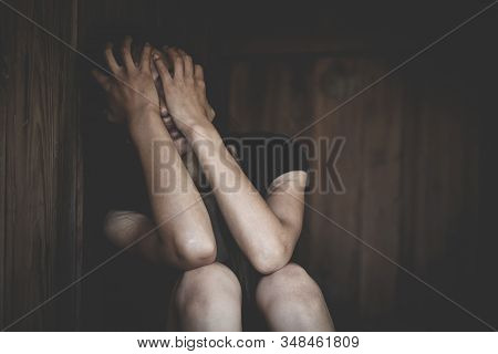 Women sitting on the floor  with depression,  family problems,  Domestic violence, Stop violence and abuse ,sexual abuse, human trafficking,  rape,  The concept of depression and suicide, stock photo