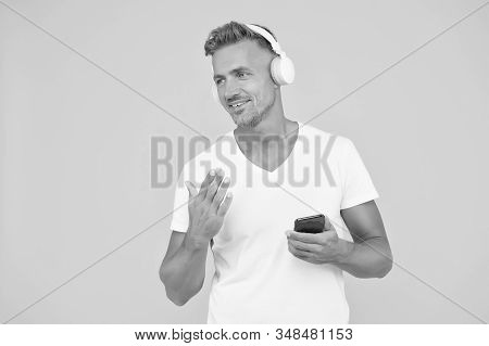 Favorite music playlist. Music subscription. Man listen music modern headphones and smartphone. Listening concept. Best music apps. You should listen this song. Guy modern user mobile application. stock photo