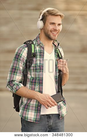 College education concept. College life. College student headphones smartphone. Online course. Audio book concept. Educational technology use physical hardware software and educational theoretic. stock photo
