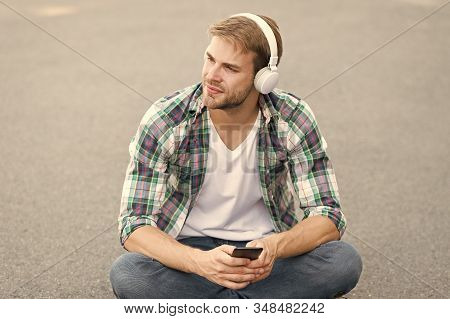 Audio book concept. Educational technology. E learning. Study anywhere. Worldwide knowledge access. Audio library. Another way of learning. Man handsome college student headphones. Online learning. stock photo