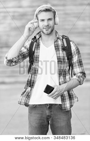 College education. College life. College student headphones smartphone. Listen music. Audio book. Modern and digital. Educational technology use physical hardware software and educational theoretic. stock photo