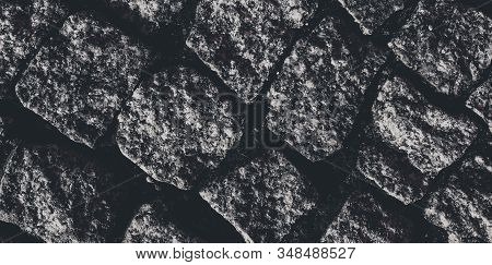 Tiles, road and paving concept - Old rustic stone pavement textured background, architectural detail material and floor surface, abstract natural texture for render, pebble medieval wall stock photo