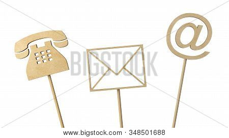 Wooden telephone, envelope letter and e-mail symbols on wood sticks isolated on white background, contact us symbols or banner, 3D illustration stock photo