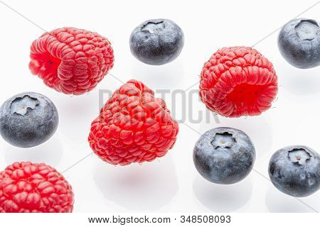 Ripe raspberries on a white background. Berries. Garden raspberries. White background. Red berries. Isolated. stock photo
