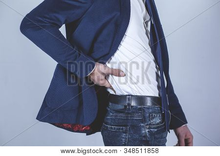 young business man hand in ache back stock photo