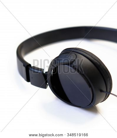 Classic black wired headphones on white background. Minimalistic music concept stock photo