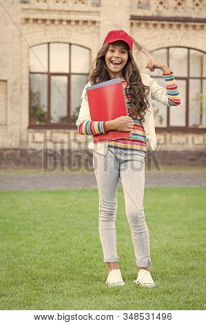Education abroad. Kid school student hold textbooks for studying. School education. Modern education. Achieving skills and knowledge. Discovering and exploring. Study hard. Informal education. stock photo