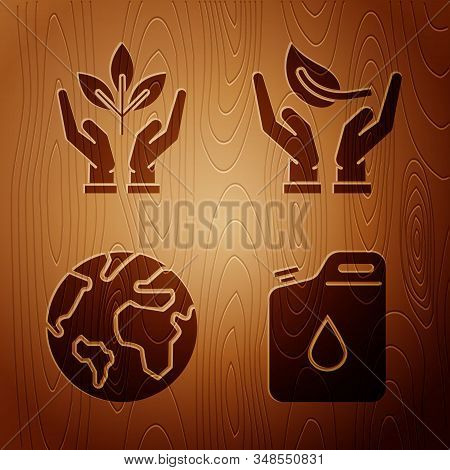 Set Canister for gasoline, Plant in hand of environmental protection, Earth globe and Sprout in hand of environmental protection on wooden background. Vector stock photo