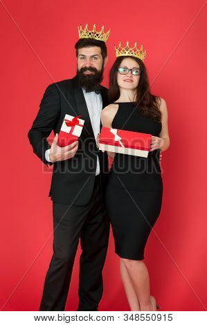 Beautiful people celebrate success. Successful and proud. Victory and triumph. Success goal. Couple in love wear crowns red background. Enjoying success. Gifted for achievements. Pride and pleasure. stock photo