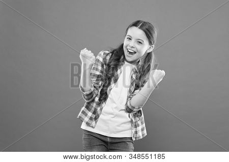 Winners never quit and quitters never win. Successful happy kid. Achieve success. Kid cheerful celebrate victory. Girl cute child happy smiling. Celebrate victory success achievement. Success gesture. stock photo