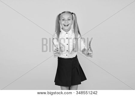 Excited about crafting. Schoolgirl hold school stationery supplies for crafts. Creative crafts. Favourite part of going back to school. Tutorials for little hands. Crafts for elementary school kids. stock photo