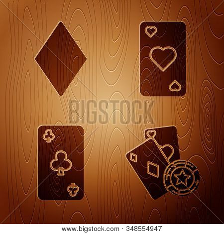 Set Casino chip and playing cards, Playing card with diamonds symbol, Playing card with clubs symbol and Playing card with heart symbol on wooden background. Vector stock photo