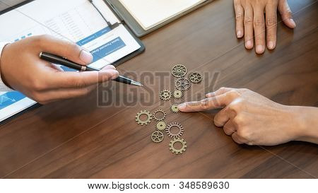 Business Solutions for Success and Strategy. Business team brainstorming and connecting the gears with a puzzle. Fulfill and fix the problem of incomplete teamwork. stock photo