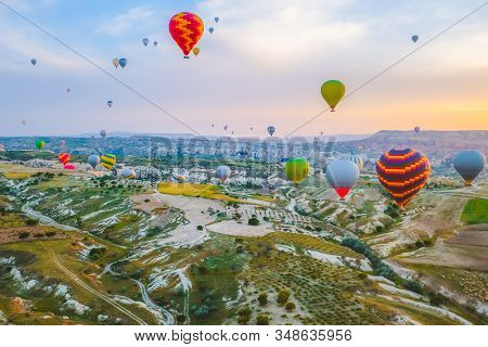 Aerial view of hot air balloons flying over spectacular at Cappadocia, Turkey. Goreme national park. stock photo
