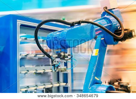 Automation system control application on automate robot arm in smart manufacturing background. stock photo