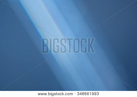 Abstract Lens Flare backdrop, Technology, prism Bokeh Lights. Photo of Leaking Reflection of a Glass, Crystal, Defocused Shining Colorful Light Leaks, Rays blue Background stock photo