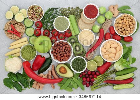 Vegan healthy food for ethical & clean eating concept with foods high in proteins, anthocyanins, vitamins, minerals, antioxidants, smart carbs and fibre. Flat lay. stock photo