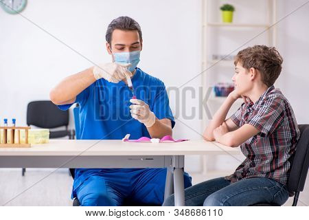 Young boy visiting doctor in hospital stock photo
