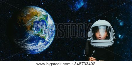 Small child wants to fly an airplane wearing an airplane helmet stock photo