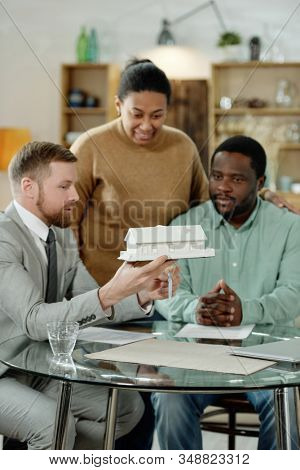 Adult African American couple having visit of professional financial accountant giving consultation on house mortgage stock photo