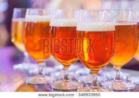 Selective Focused Glasses of Draught Beer or Craft Beer, Refreshment, Liquor, Alcoholic Drink, Beverage. Celebration Party Background. Beer brewed from cereal grain by brewer, Brewing Industry concept stock photo