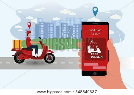 Food delivery app on a smartphone tracking a delivery man on a moped with a ready meal. Delivery bike with cardboard box on mobile phone and city background. stock photo
