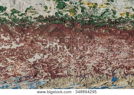 texture of old peeling paint, vintage background, cracked paint, old paint, traces of red, white, green, blue and yellow paint stock photo