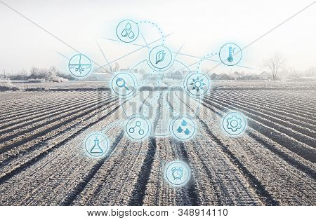 Futuristic innovative technology pictogram on a winter farm field. Agricultural startups, improvements, digitalization agricultural industry. Internet of things in farming. Preparing for next season stock photo