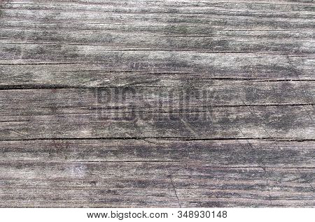 Old board. Cracks on the board. wood texture. wood material. wooden background. light brown background. stock photo