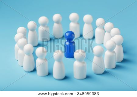 A team of white people stands around and listens to the leaders blue leader. The concept of the leader of the business team. stock photo